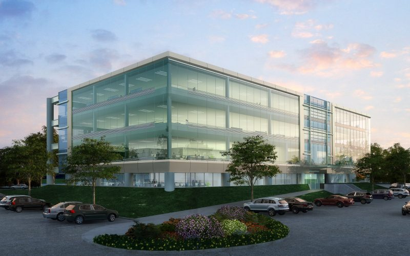Photorealistic rendering of suburban office building at dusk