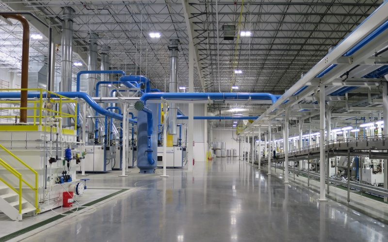 Interior of manufacturing space with piping