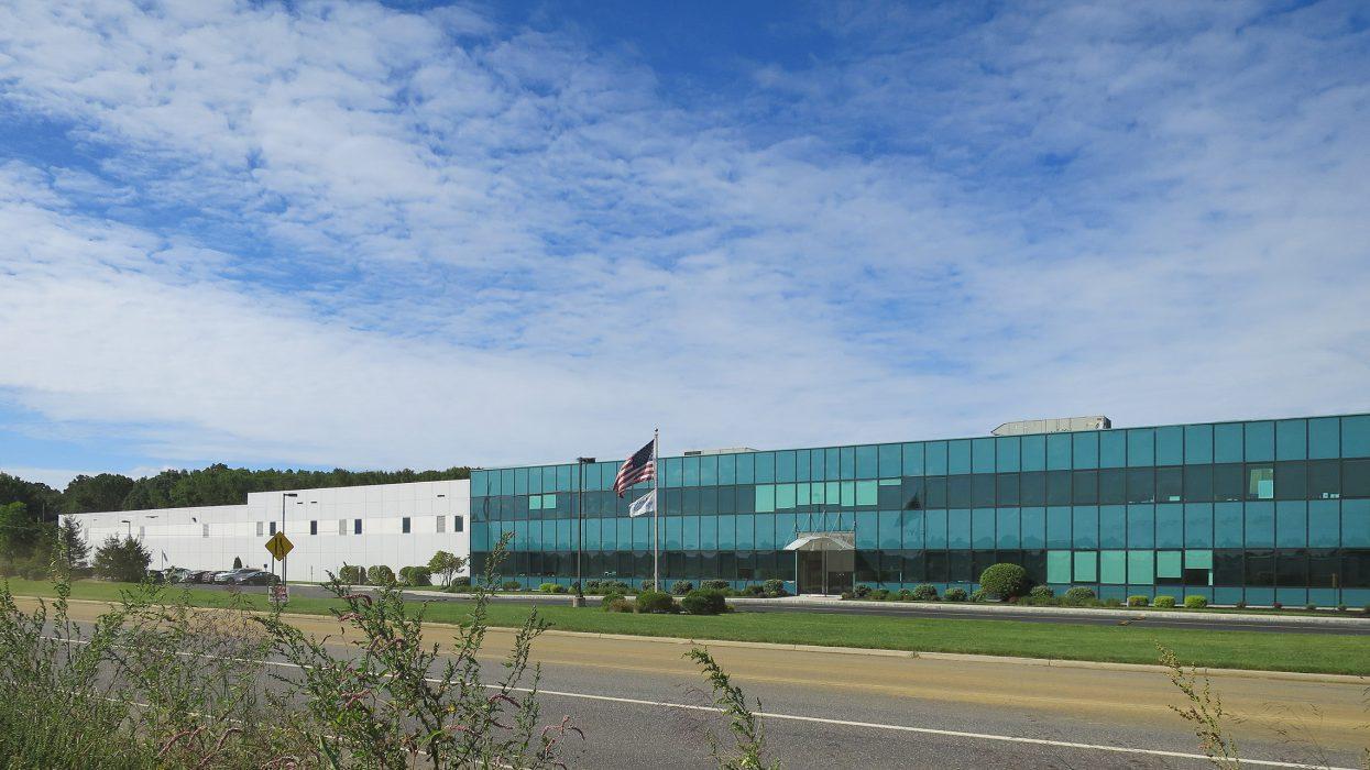 Exterior facade of industrial building fwith glass facade