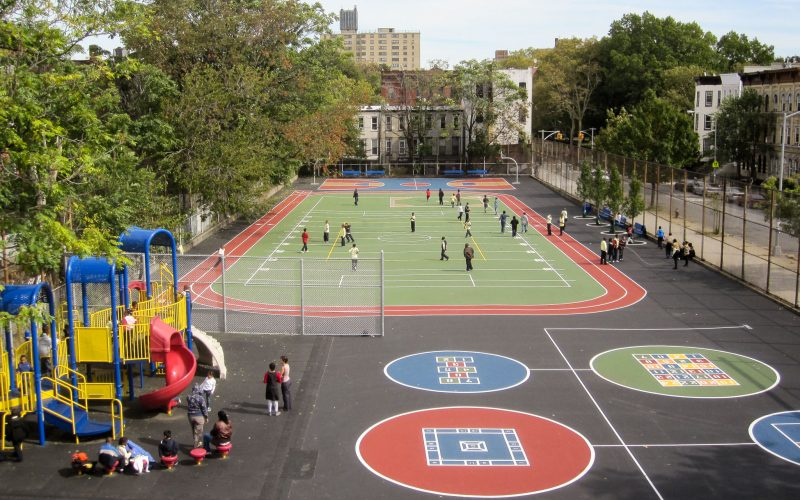 Athletic field and playground in urban schoolyard