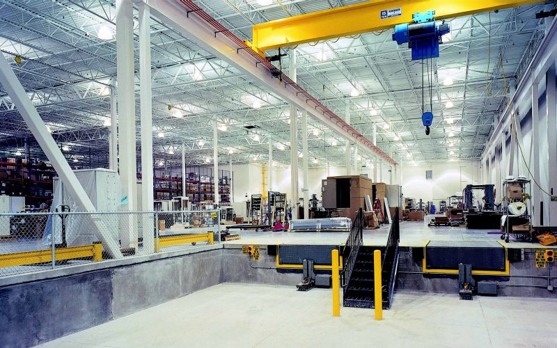 Interior view of industrial space with overhead crane and loading dock
