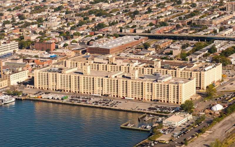 Aerial view of complex of buildings - Brooklyn Army Terminal from harbor