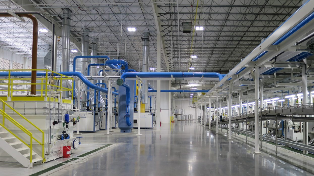 Manufacturing facility with piping and production equipment
