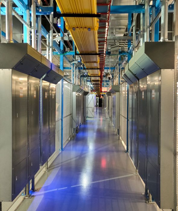 Aisle with electrical and data equipment in colocation center