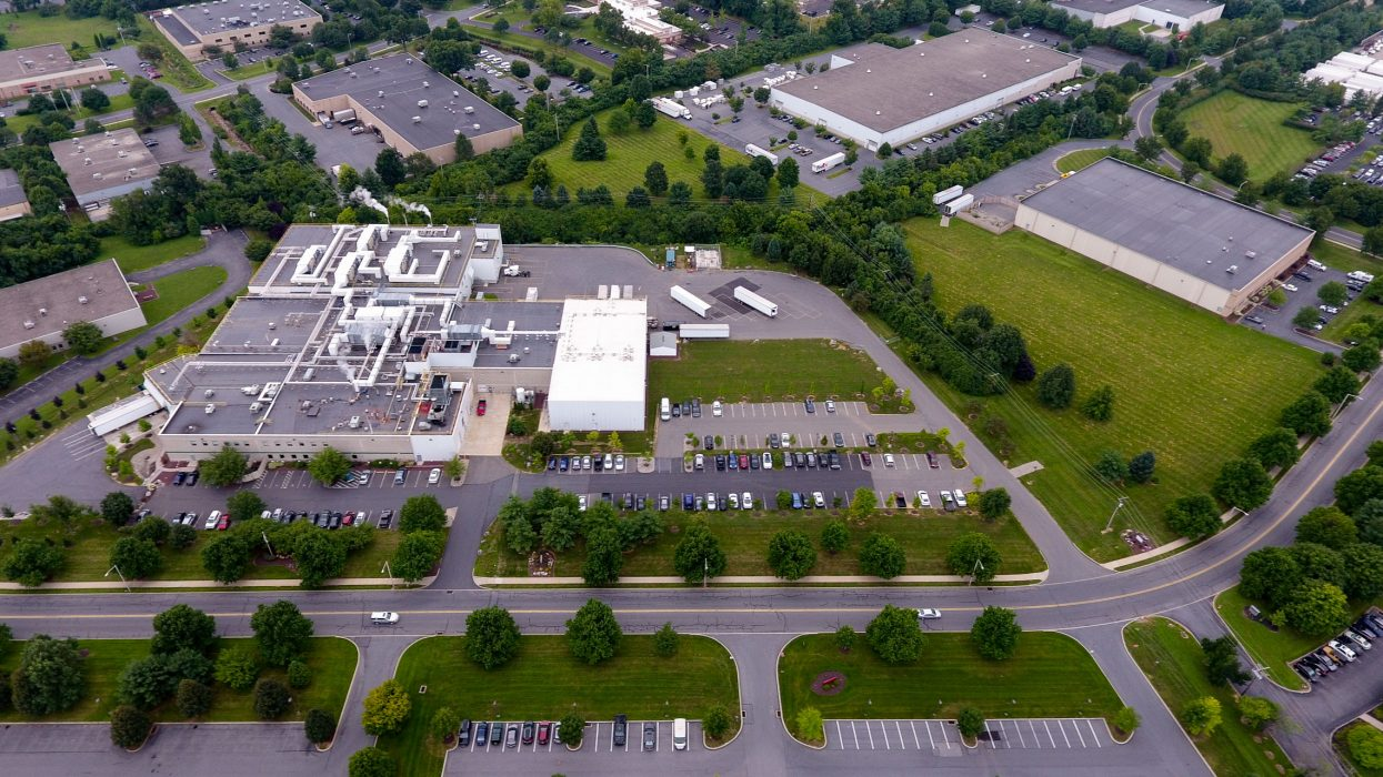 Aerial of food processing complex with open lot
