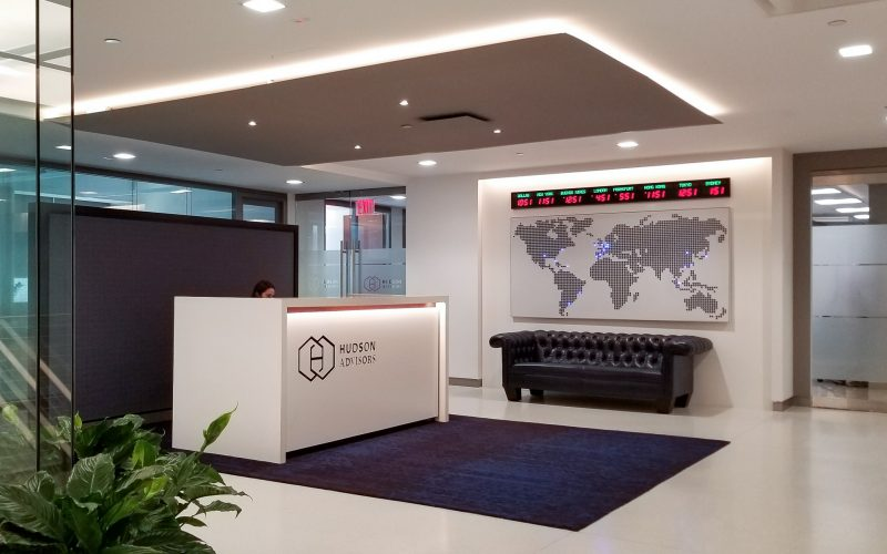Office interior with front desk, wall map
