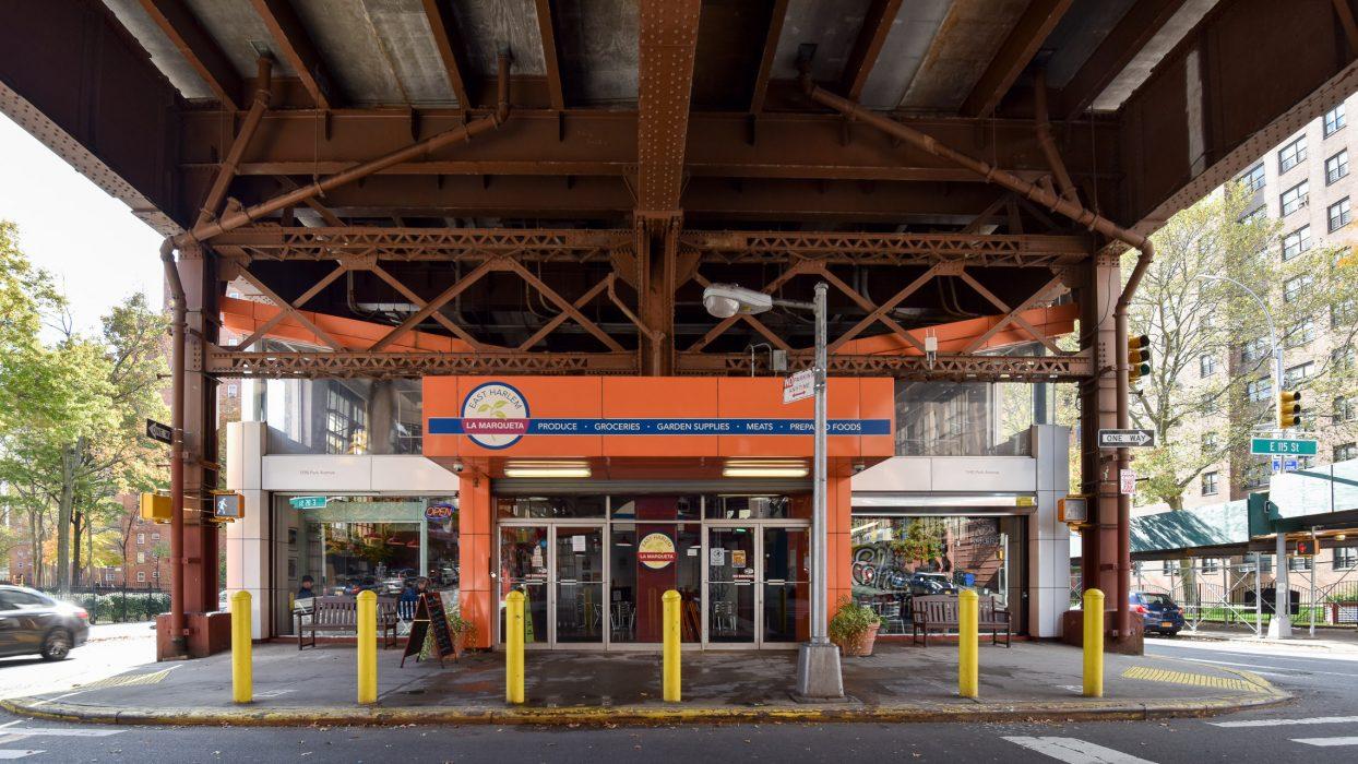 Market storefront under railroad viaduct