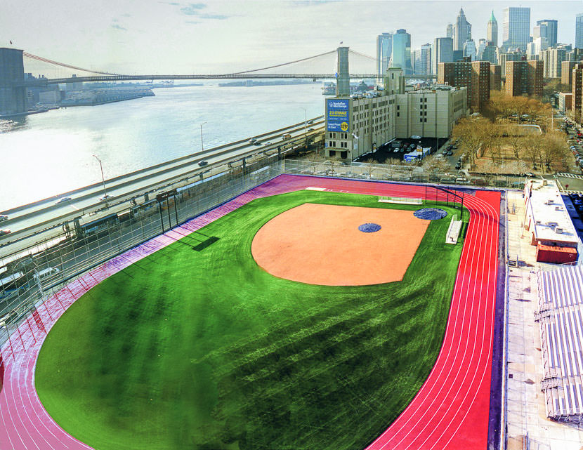 Aerial view of athletic field with Brooklyn Bridge in distance