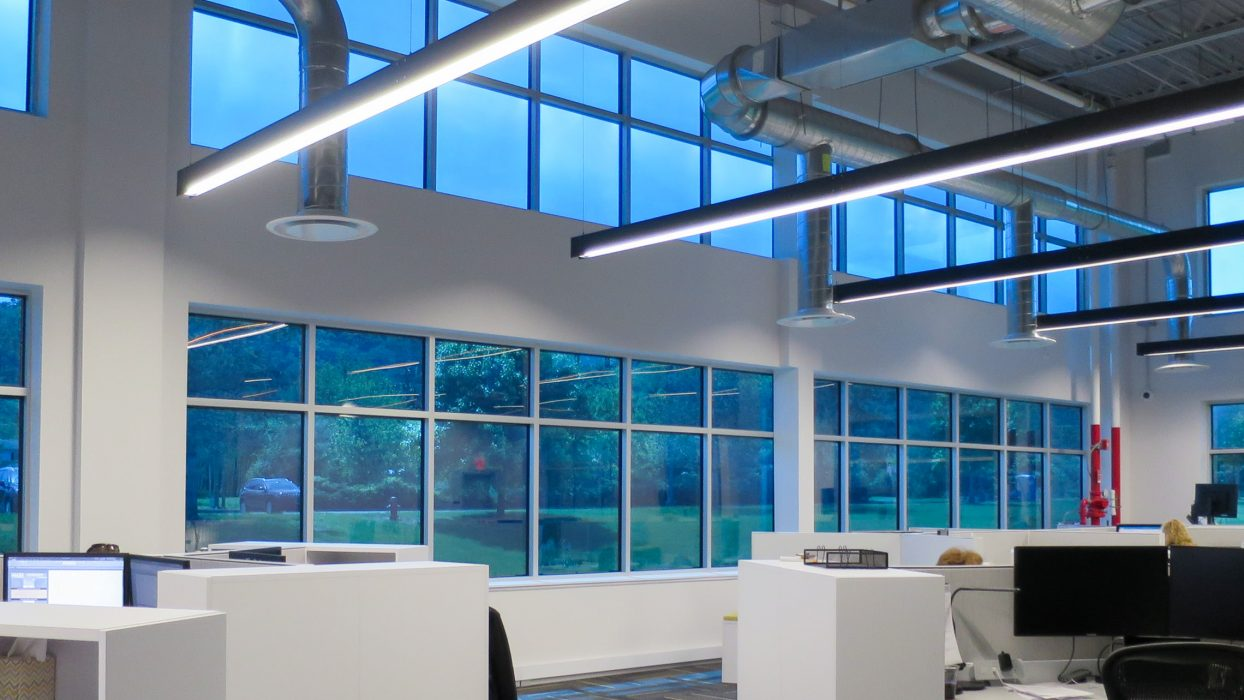 Interior view of wall of windows with specialty Sage glass