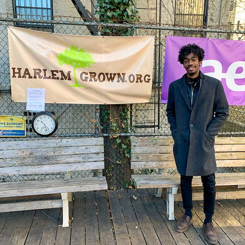 Jeremy in front of Harlem Grown banner