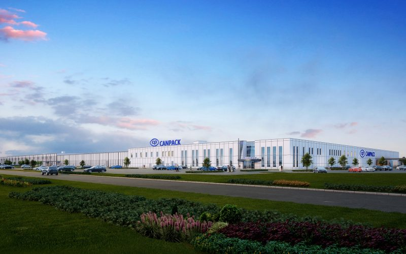 "Exterior rendering of new manufacturing facility with ""CANPACK"" sign"