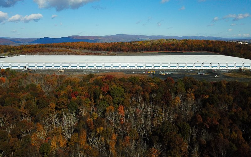 Aerial of new logistics building with fall foliage