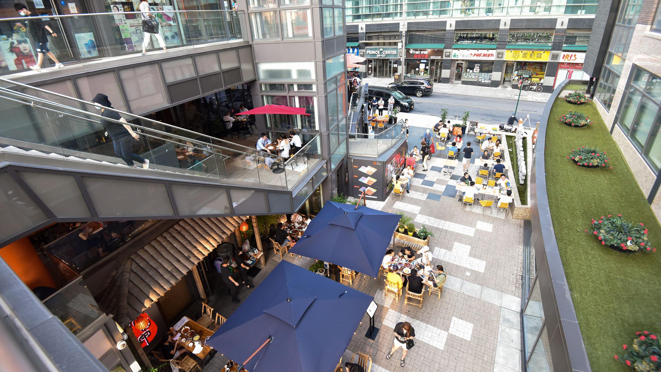 Overlooking outdoor area with restaurant dining